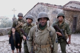 (L TO R) Matteo Sciabordi, Omar Benson Miller (behind Matteo) Michael Ealy, Derek Luke (forefront), Laz Alonso. This film chronicles the story of four black American soldiers stationed in Tuscany, Italy during Word War II.